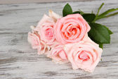 Beautiful bouquet of roses on table close-up — Stock Photo