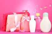 Baby cosmetics and towels on pink background — Stock Photo
