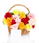 Beautiful bouquet of roses in wicker basket isolated on white — Stock Photo