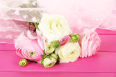 Ranunculus (persian buttercups), on pink wooden background — Stock Photo