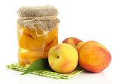 Jar of canned peaches and fresh peaches, isolated on white — Stock Photo