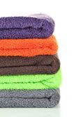 Hromadu barevné ručníky, izolované na bílém — Stock fotografie