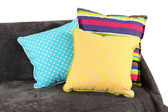 Colorful pillows on couch isolated on white — Stok fotoğraf
