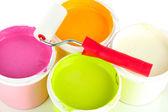Set for painting: paint pots, paint-roller close up — Stock Photo