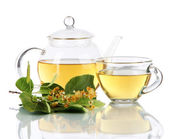 Kettle and cup of tea with linden isolated on white — Stock Photo