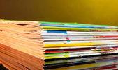 Many magazines on yellow background — Stock Photo
