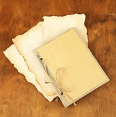 Old papers on wooden background — Stock Photo