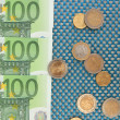 Euro banknotes and euro cents on blue background — Stock Photo #27492581