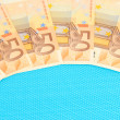 Euro banknotes on blue background — Stock Photo