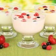 Delicious yogurt with fruit on table on bright background — Foto de Stock