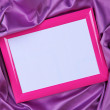 Empty frame on beautiful silk background — Stock Photo #27497331