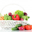 Fresh vegetables in white wicker basket on grey background — Stock Photo