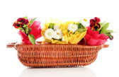 Beautiful spring flowers in basket isolated on white — Stock Photo