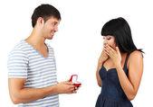 Man maakt vrouw aanbieding krijgen betrokken geïsoleerd op wit — Stockfoto