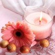 Beautiful pink candle with flower in water — Stock Photo #27544457