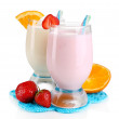 Delicious milk shakes with orange and strawberries isolated on white — Stock Photo