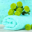 Beautiful green chrysanthemum with towel on table on blue background — Stock Photo