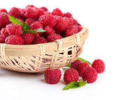 Ripe sweet raspberries in basket, isolated on white — Stock Photo