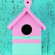 Decorative nesting box on color wooden background — Stock Photo