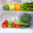 Open refrigerator with vegetarian food — Stock Photo