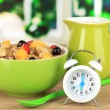Oatmeal with fruits on table in kitchen — Stock Photo
