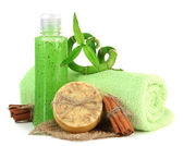 Bottle with scrub and hand-made soap, isolated on white — Stock Photo