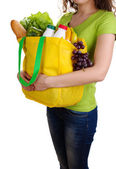 Girl with shopping bag isolated on white — Stok fotoğraf