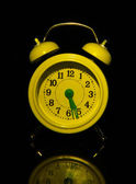 Old style alarm clock isolated on black — Stock Photo