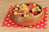 Oatmeal with fruits on table close-up — Stock Photo