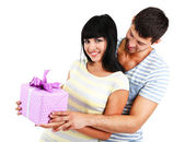 Beautiful loving couple with gift isolated on white — Stock Photo