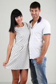 Beautiful loving couple together on grey background — Stock Photo