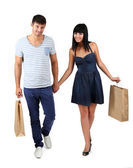 Beautiful loving couple is shopping isolated on white — Stock Photo