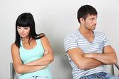 Beautiful loving couple quarrel in room — Stock Photo