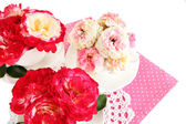 Roses in cups on napkins isolated on white — Stock Photo