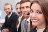Call center operators at work — Stock Photo