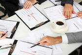 Businesspartners hands during discussion of papers close up — Stock Photo
