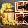 Stock Photo: Wooden case with wine bottle, barrel, wineglass and grape on wooden table on grey background