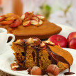 Stock Photo: Slice of tasty homemade pie with chocolate and apples, on wooden table
