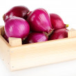Purple onion in wooden box isolated on white — Stock Photo