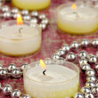 Lighted candles with beads close up — Stock Photo #27736143