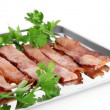 Fried bacon on metal tray isolated on white — Stock Photo #27737207