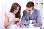 Business partners discussing their business project in cafe — Stock Photo
