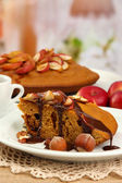 Slice of tasty homemade pie with chocolate and apples, on wooden table — Stock Photo