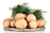Potato and dill on wicker wooden tray isolated on white — Stock Photo