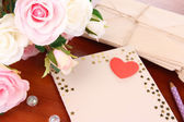 Writing letter of congratulations to mother's Day on wooden table close-up — Stock Photo