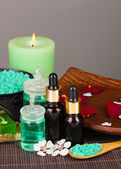 Spa composition with aroma oils on table on gray background — Stock Photo
