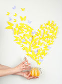 Paper yellow butterfly in form of heart fly out bank — Foto Stock