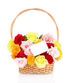 Beautiful bouquet of roses in wicker basket isolated on white — Stockfoto