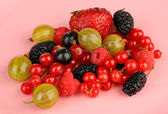 Ripe berries on pink background — Stock Photo