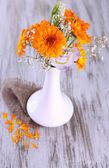 Calendula flowers in vase on wooden background — Stock Photo